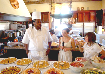 Rick Johnson, owner and operator              of Metro City Wings catering, being interviewed at P. Diddy's All White 4th of July event, he was hired to cater.
