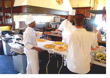 Rick Johnson being filmed in the              Kitchen at P. Diddy's All White 4th of July event.